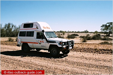 Outback camper crossing Cooper Creek