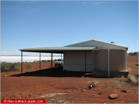 corrugates iron hut to protect visitors from the sun