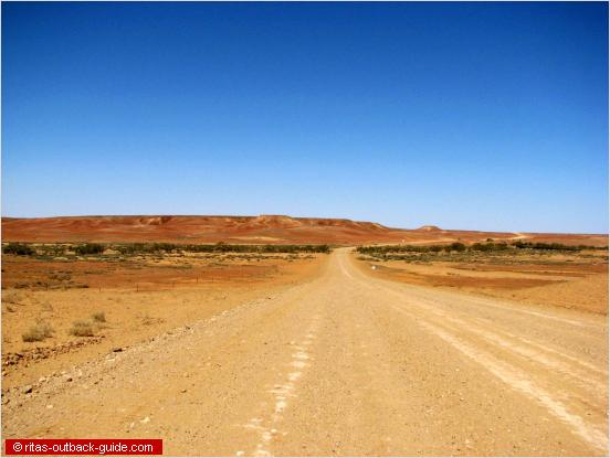 outback road with colourful hills