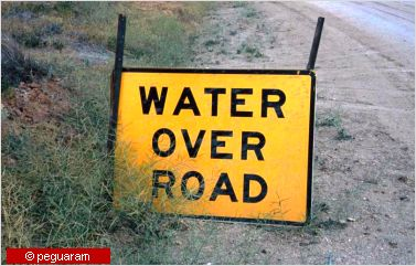 The water over road sign means to take extreme care