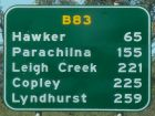 road sign with travel distances