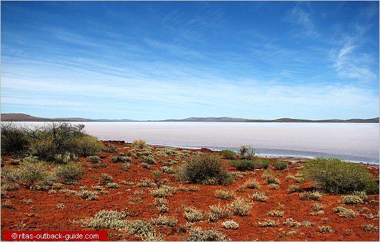salt lake with hills on the horizon