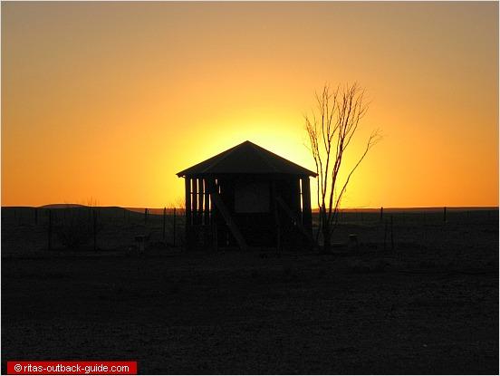 hut at sunset