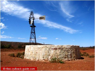 windmill and stone well