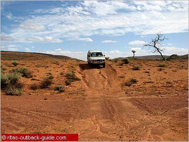 car crossing a dry creek bed