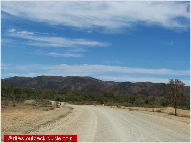 gravel road and mountain range