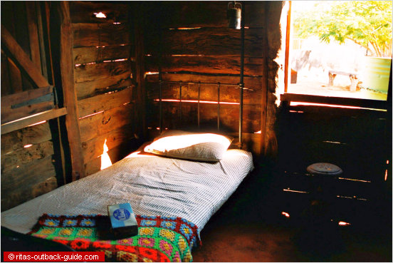 basic bed in a wooden shed