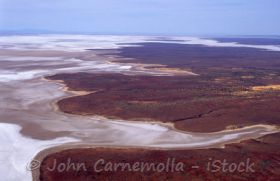 Go and learn about Lake Eyre Aerial view of the lake - photo © John Carnemolla