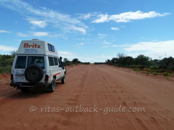 A rough road in the Outback, and a 4WD camper.
