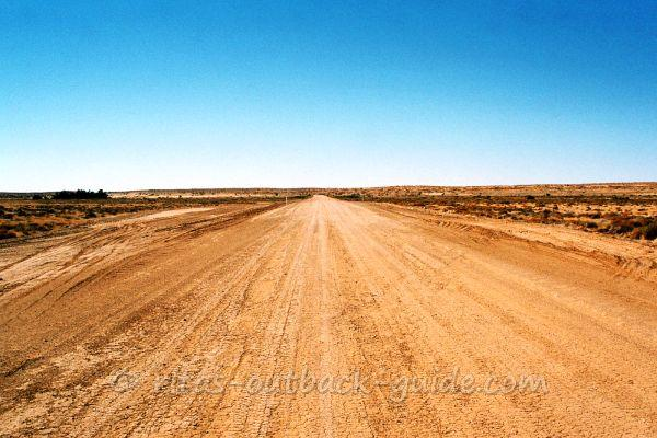 A wide empty road in the Australian Outback