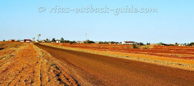 A dusty road leading into a dusty town, Birdsville