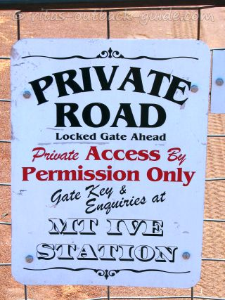 sign at a station gate saying private road