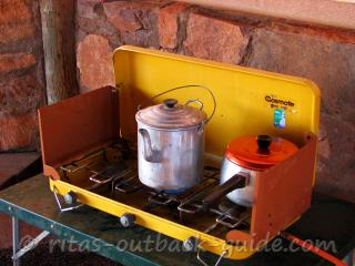 A kettle and a pot on a camping stove