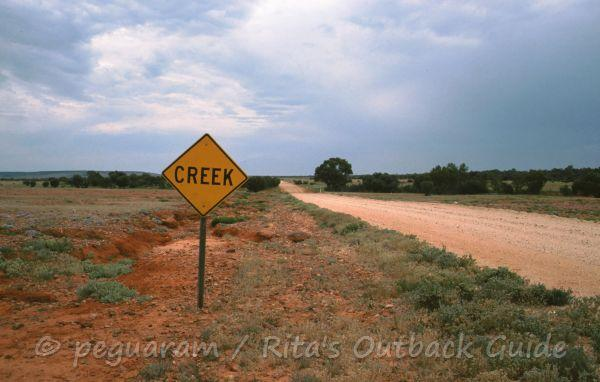Sign announcing a creek crossing
