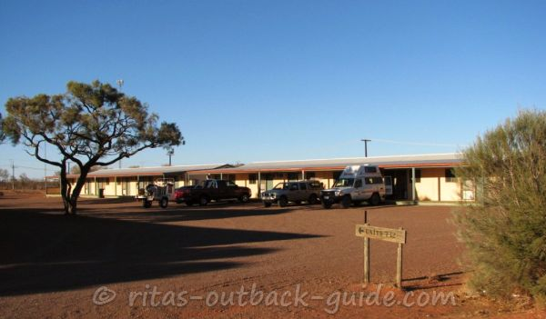 A row of motel rooms in the afternoon sun, Glendambo