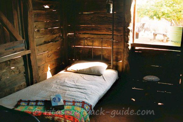 A basic bed in a wooden shed - accommodation in the Outback is much better these days