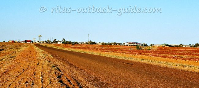 A dusty road leading into a dusty town, Birdsville