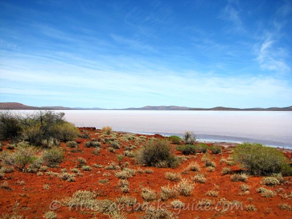 The colours of the Outback - red earth, blue sky, and a shimmering salt lake